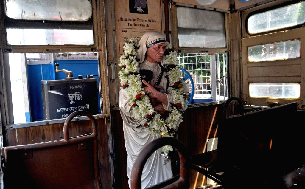 A statue of  Saint Teresa of Calcutta in a tram decorated to pay tribute to her in Kolkata on Sept 18, 2016.
