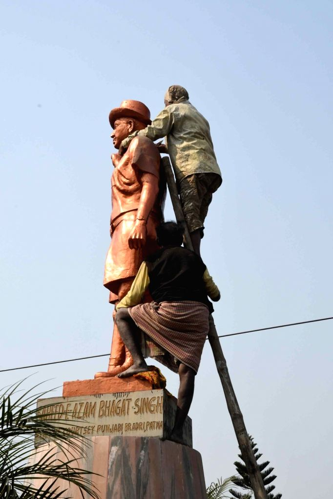 A statue of Shaheed Bhagat Singh being cleaned up on the eve of Republic Day, in Patna on Jan 25, 2020. - Bhagat Singh