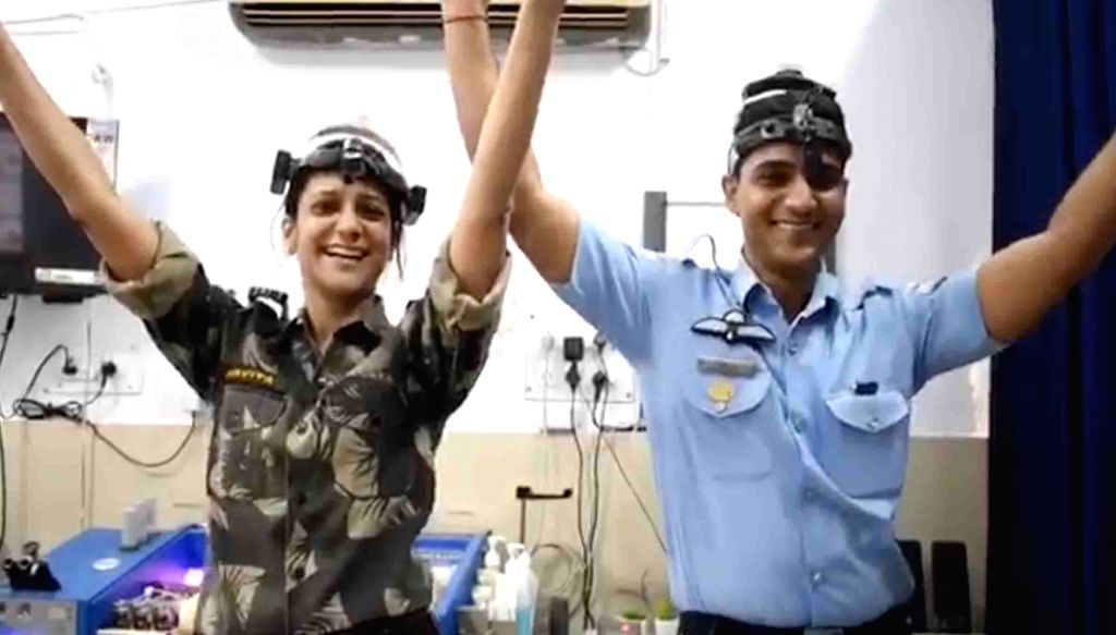 """A still from a fun video of military doctors and nursing staff happily dancing to the tune of Pharrell Williams' hit song """"Happy"""" that has gone viral, on April 27, 2019. The video, said to be shot at 12 Air Force Hospital at Gorakhpur in Uttar Prades"""