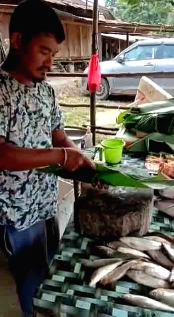 A still from a video shared by Union Minister Kiren Rijiju which features a meat vendor who is wrapping meat in leaves instead of plastic before handing it over to a customer. The Minister ... - Kiren Rijiju