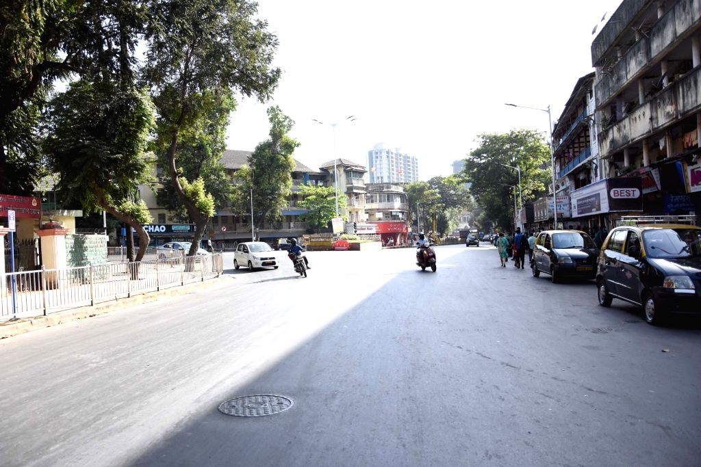 A street bears a deserted look after Maharashtra Chief Minister Uddhav Thackeray called for a lock down in Mumbai among other cities in view of the growing number of COVID-19 (coronavirus) ... - Uddhav Thackeray