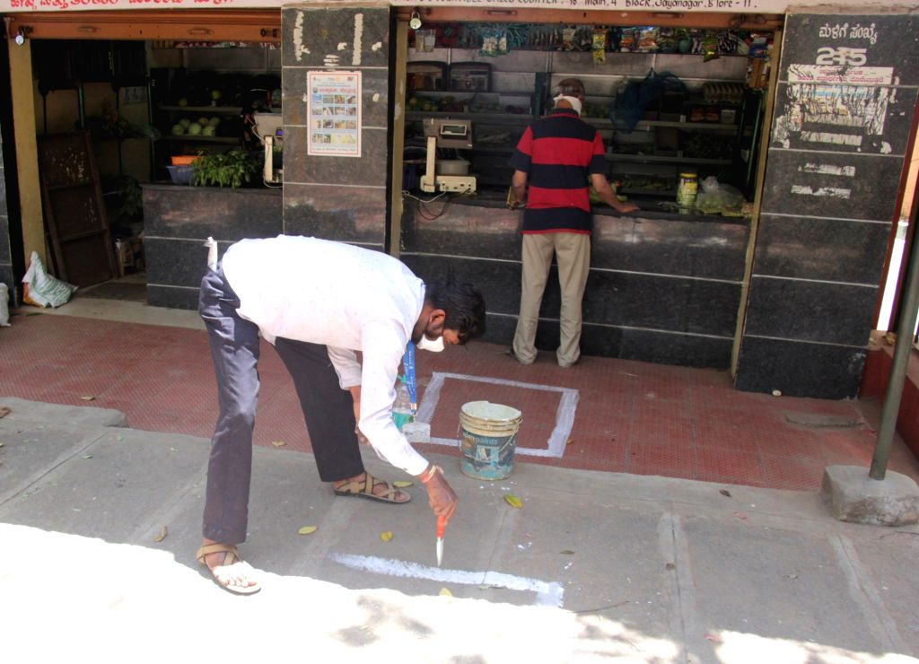 A street besides a store being marked with white paint to assist people in following social distancing on Day 6 of the 21-day countrywide lockdown imposed to contain the spread of novel ...
