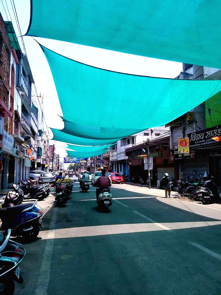 A street covered in a sunblock shade cloth on a hot day, in Raipur, on May 26, 2019.