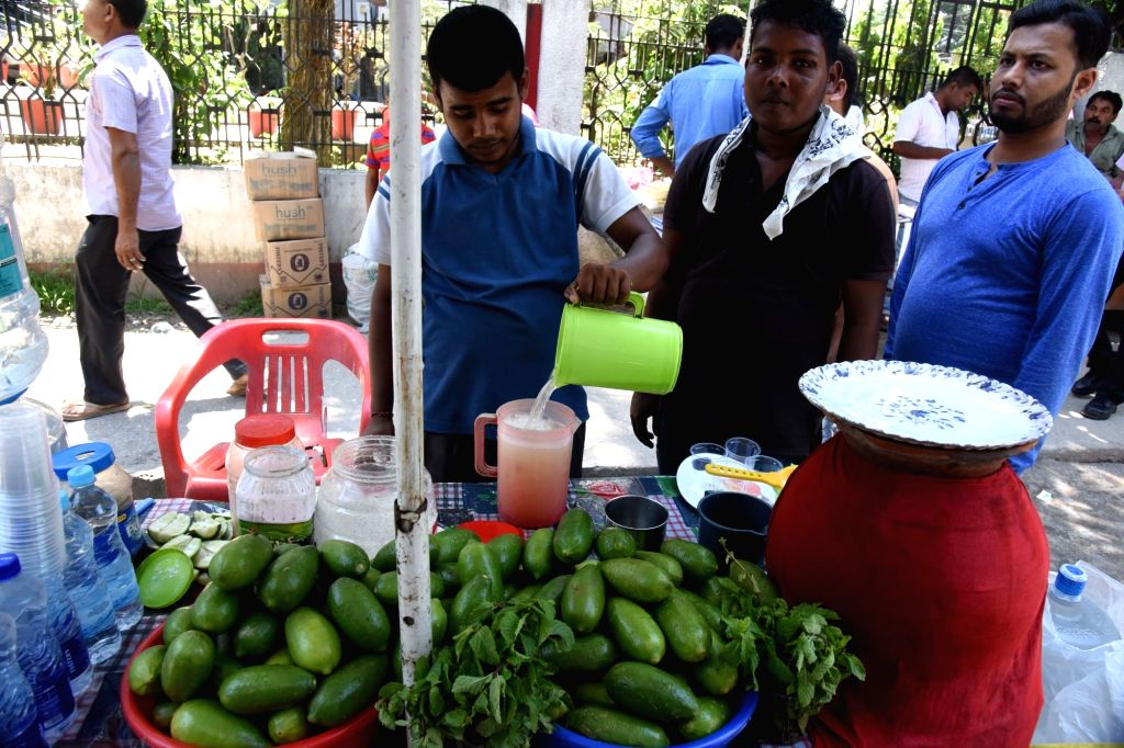 A street vendor sells lemonade on a hot day in Guwahati on May 18, 2017.