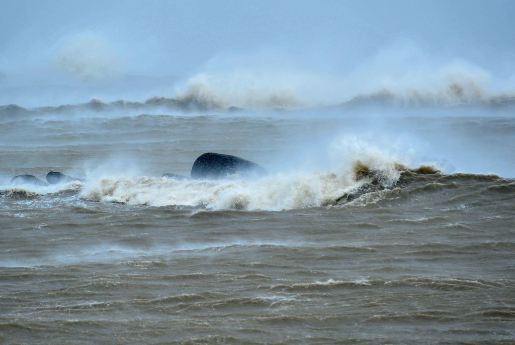 A strong sea wave is seen in Putian City, southeast China's Fujian Province, Aug. 8, 2015. Fujian Province on Saturday issued its highest typhoon alert as super ...