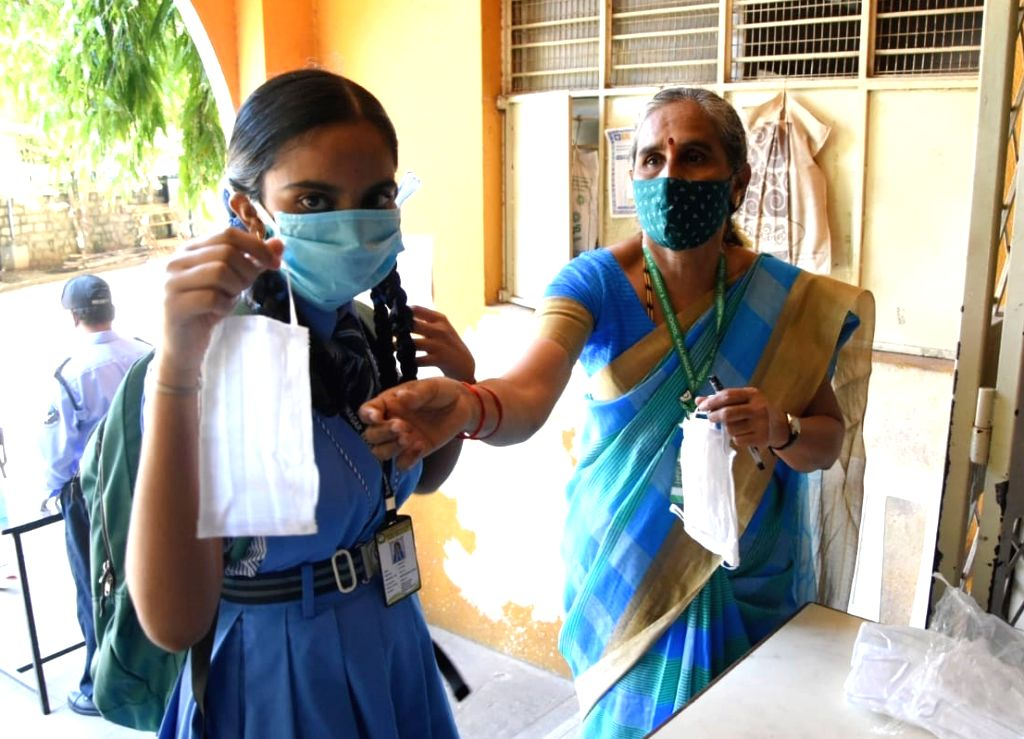 A student arrives wearing a mask to appear for the remaining Secondary School Leaving Certificate (SSLC) examinations, in Bengaluru on June 25, 2020.