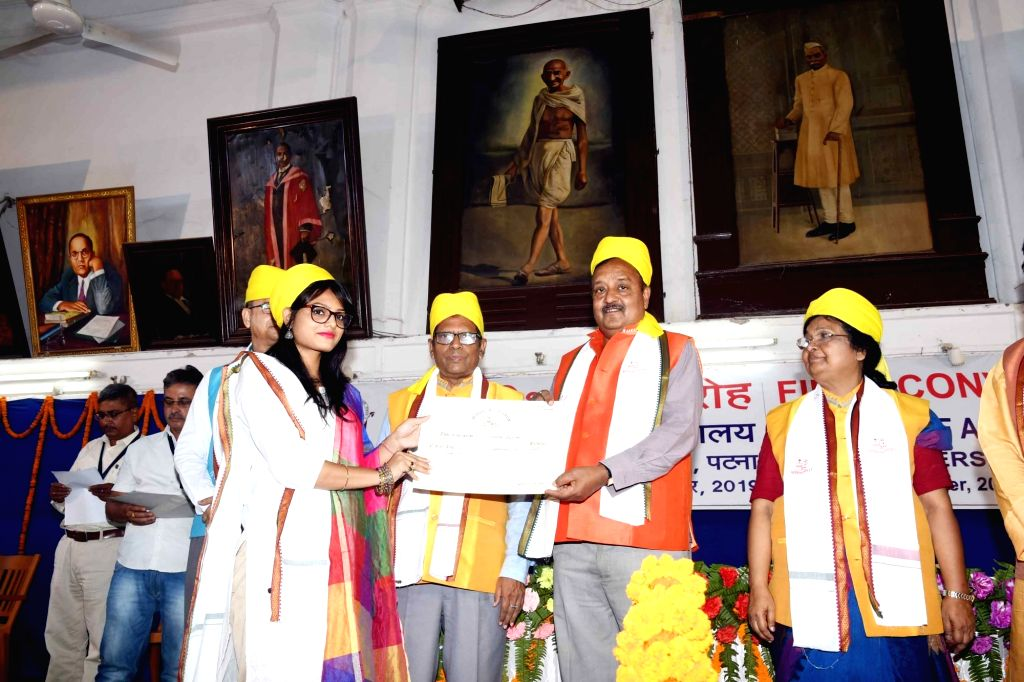 A student being awarded with the degree at the First Convocation ceremony of College of Arts & Crafts, Patna University on Sep 6, 2019.