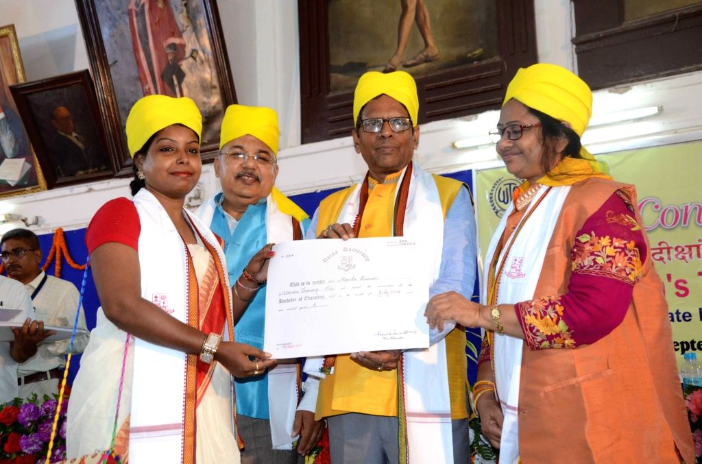 A student being awarded with the degree at the convocation ceremony of Women's Training College in Patna on Sep 6, 2019.