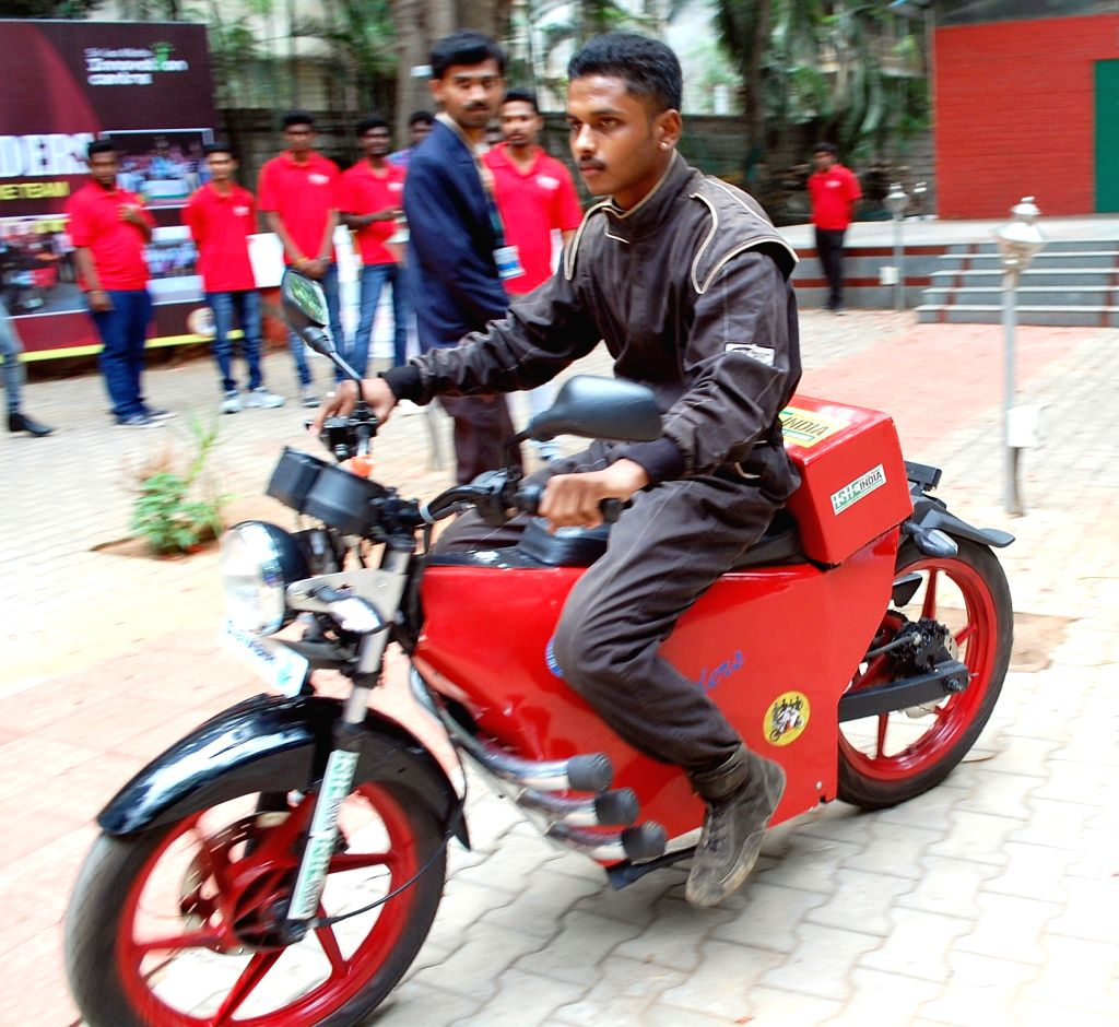 A student of Bengaluru engineering college showcases an E-bike on May 25, 2017.