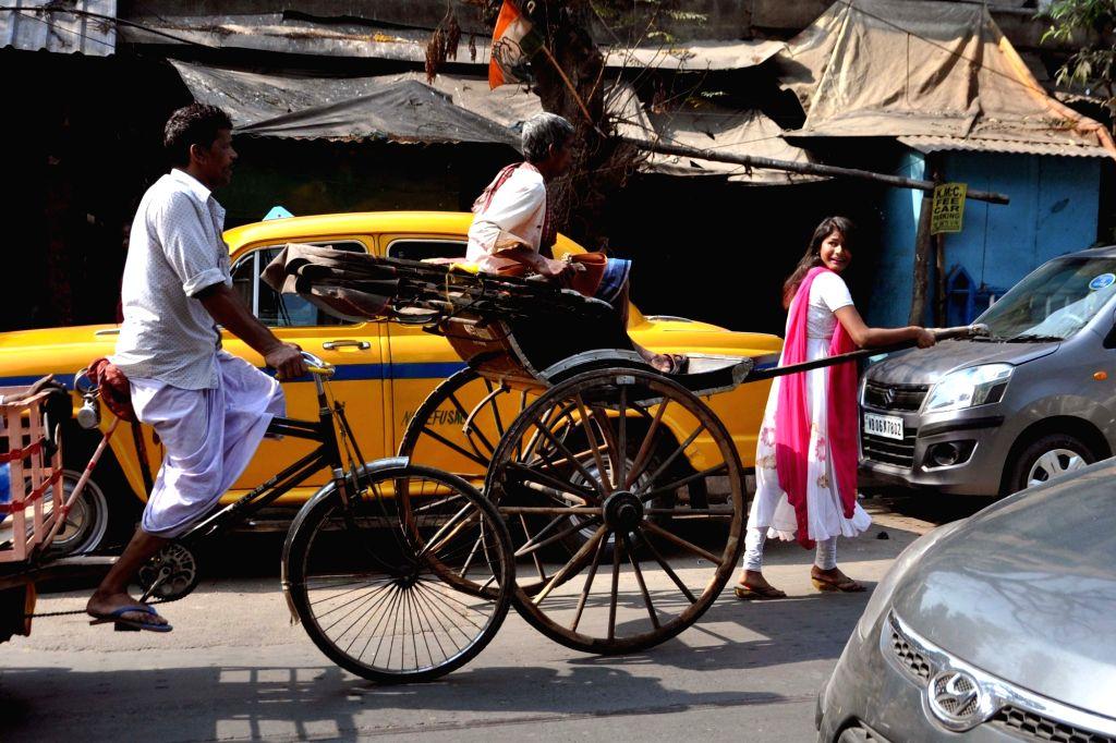 A student pulls a rickshaw puller on Valentine's Day in Kolkata, on Feb 14, 2019.
