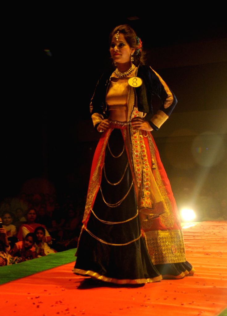 A student walks the ramp during a fashion show organised in a college in Amritsar, on April 9, 2016.