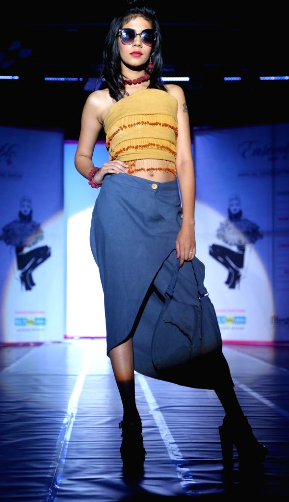 A student walks the ramp during ENSEMBLE 2017 fashion show in Jalandhar on May 15, 2017.