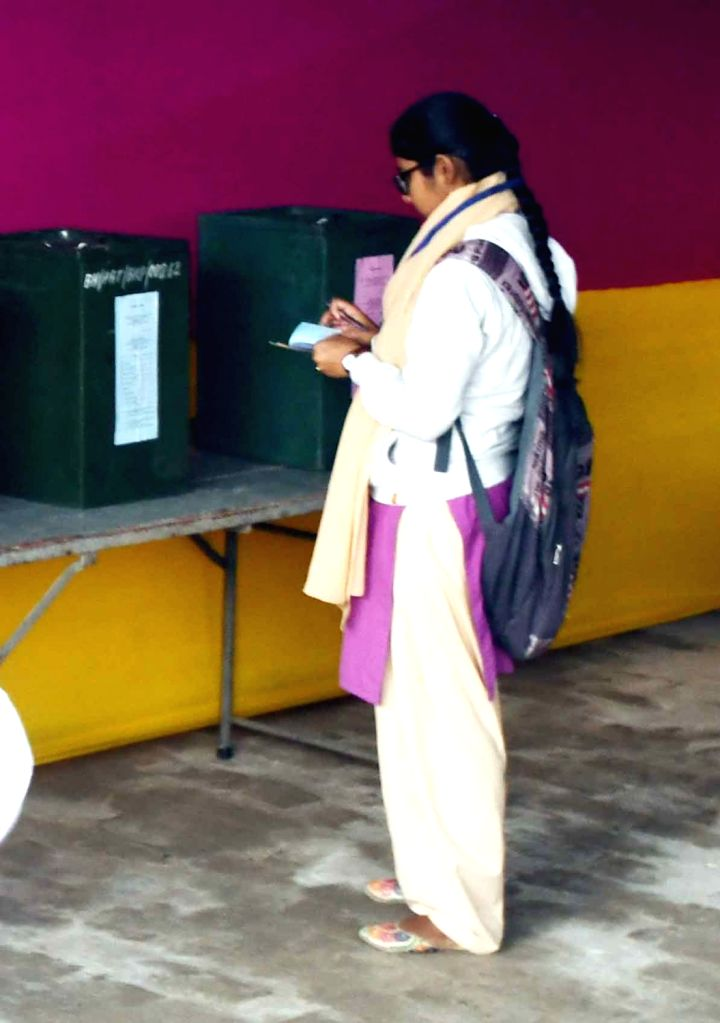 A students cast her vote through ballot paper for Patna University Students Union elections, on Dec 7, 2019.