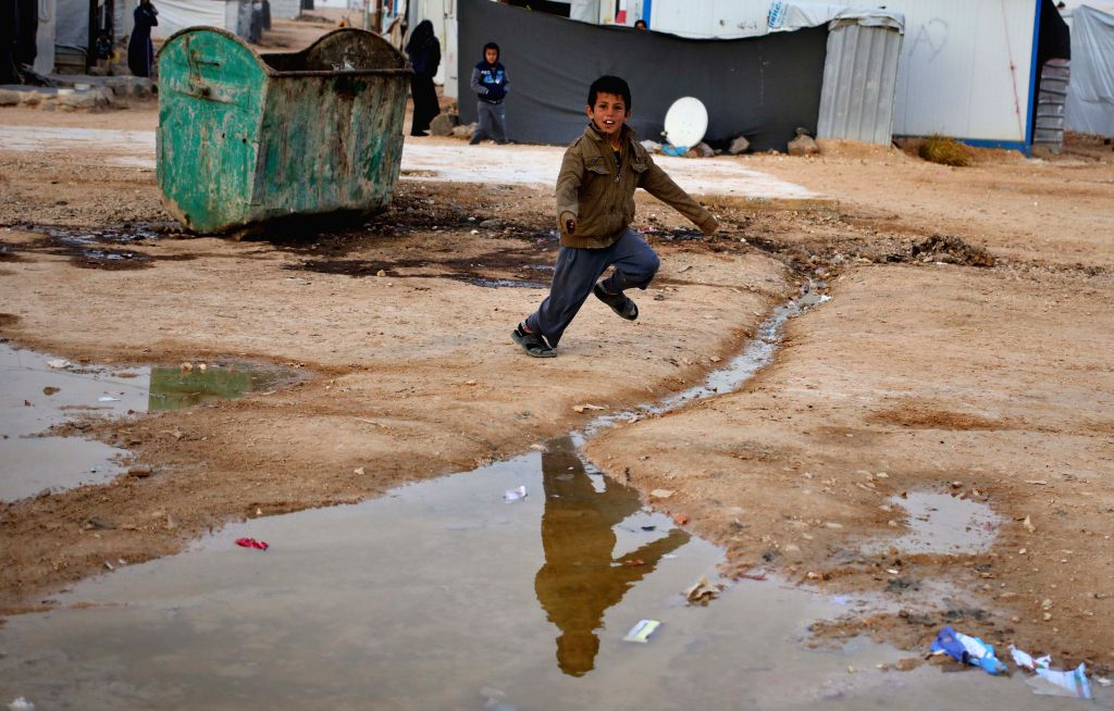 A Syrian refugee boy plays at Zattari Syrian refugee camp near the city of Mafraq, Jordan on Jan. 18, 2016.