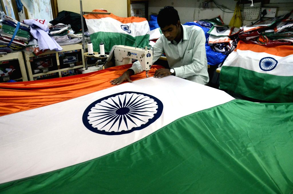 A tailor busy making the national flag ahead of Independence Day at a workshop in Mumbai, on Aug 8, 2015.