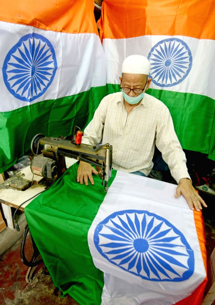 A tailor busy stitching a tricolor ahead of Independence Day celebrations, in Kolkata on Aug 10, 2020.
