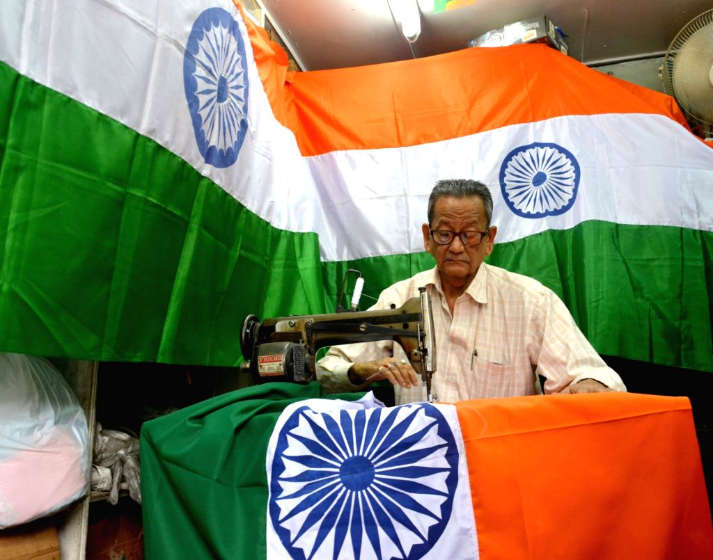 A tailor busy stitching tricolours ahead of Independence Day in Kolkata on Aug 7, 2018.