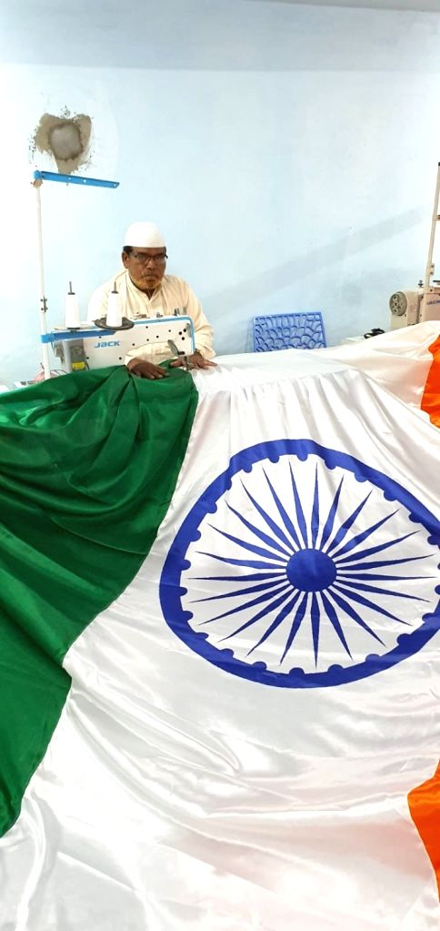 A tailor stickers a tricolor at a workshop ahead of the Tiranga rally' organised by the All India Majlis-e-Ittehadul Muslimeen (AIMIM) to protest against the Citizenship Amendment Act in ...