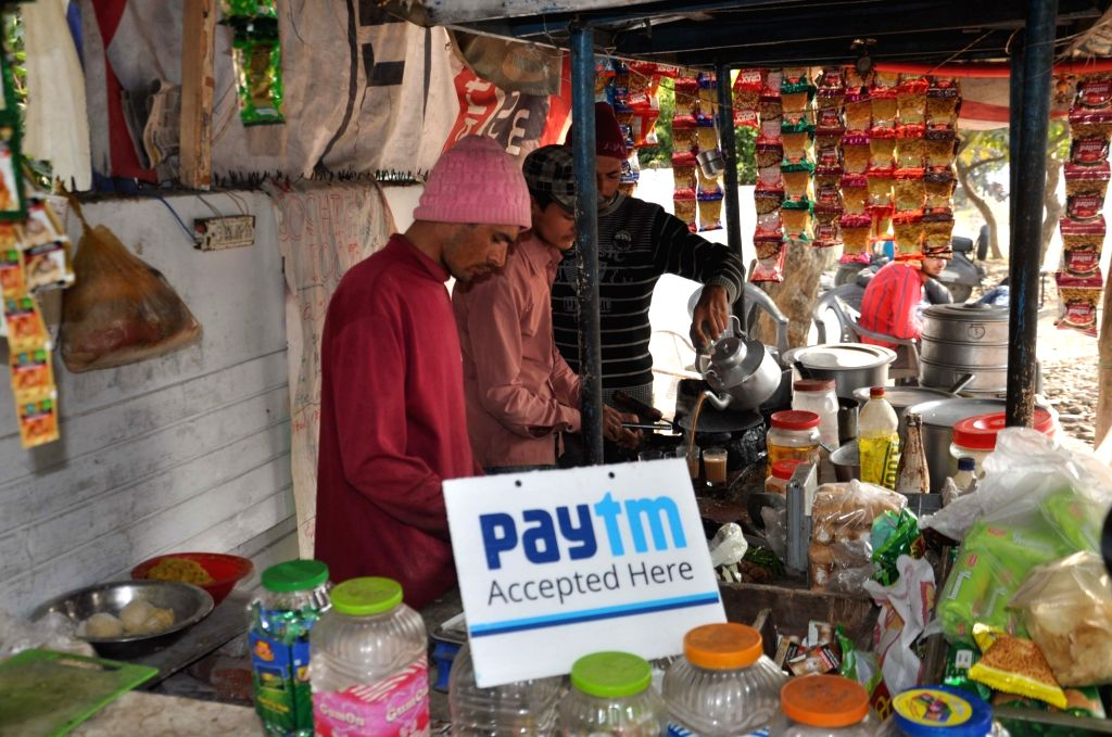 A tea stall owner display a sign accepting mobile payment in Dehradun on Nov. 19, 2016.