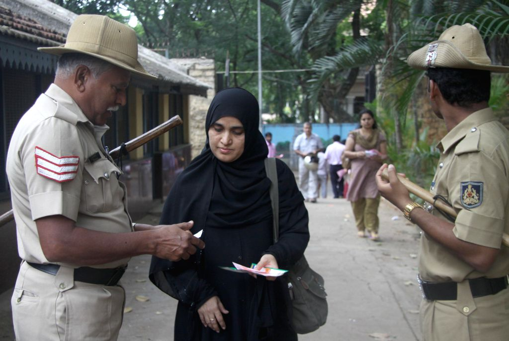 A teacher arrives to cast her vote during Teachers Constituency Election at Freedom Park in Bangalore on June 20, 2014.
