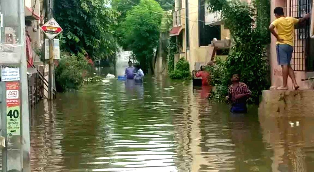 A team of Greater Hyderabad Municipal Corporation (GHMC) pressed ito action to rescue and evacuate people in flooded Hyderabad on Sep 27, 2019.