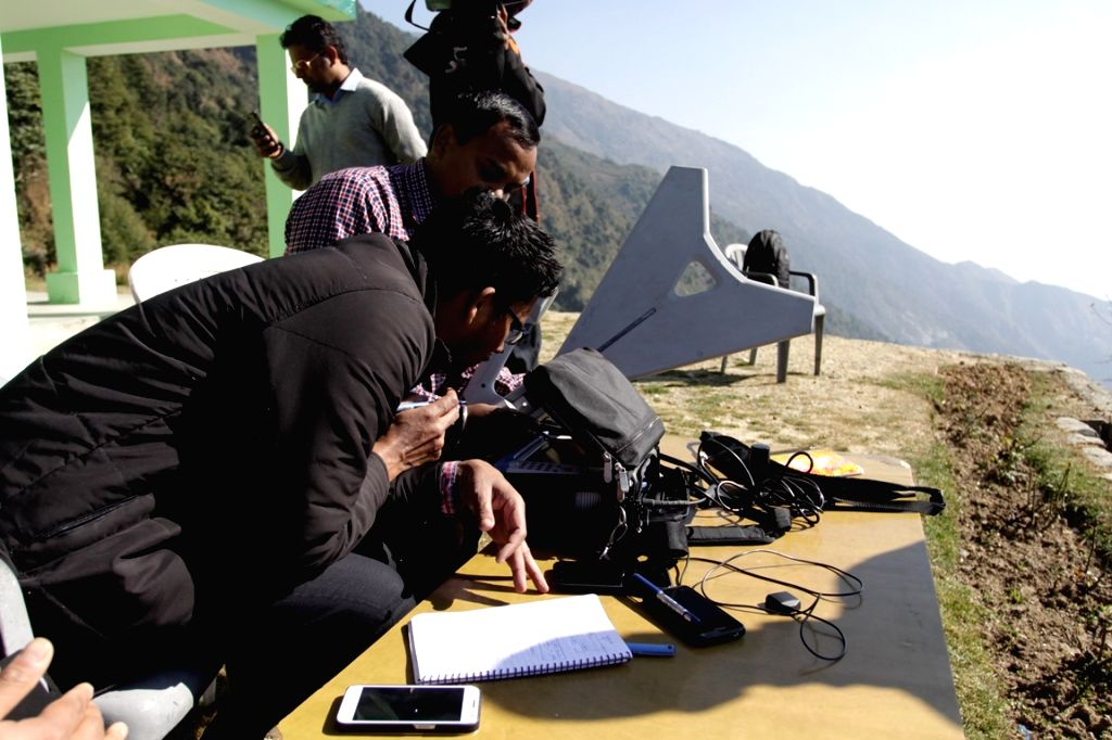 A team of Indian Governments'  Telecommunication Department verifies  Pakistan telecom signals in Dharamsala on Nov 19, 2015.