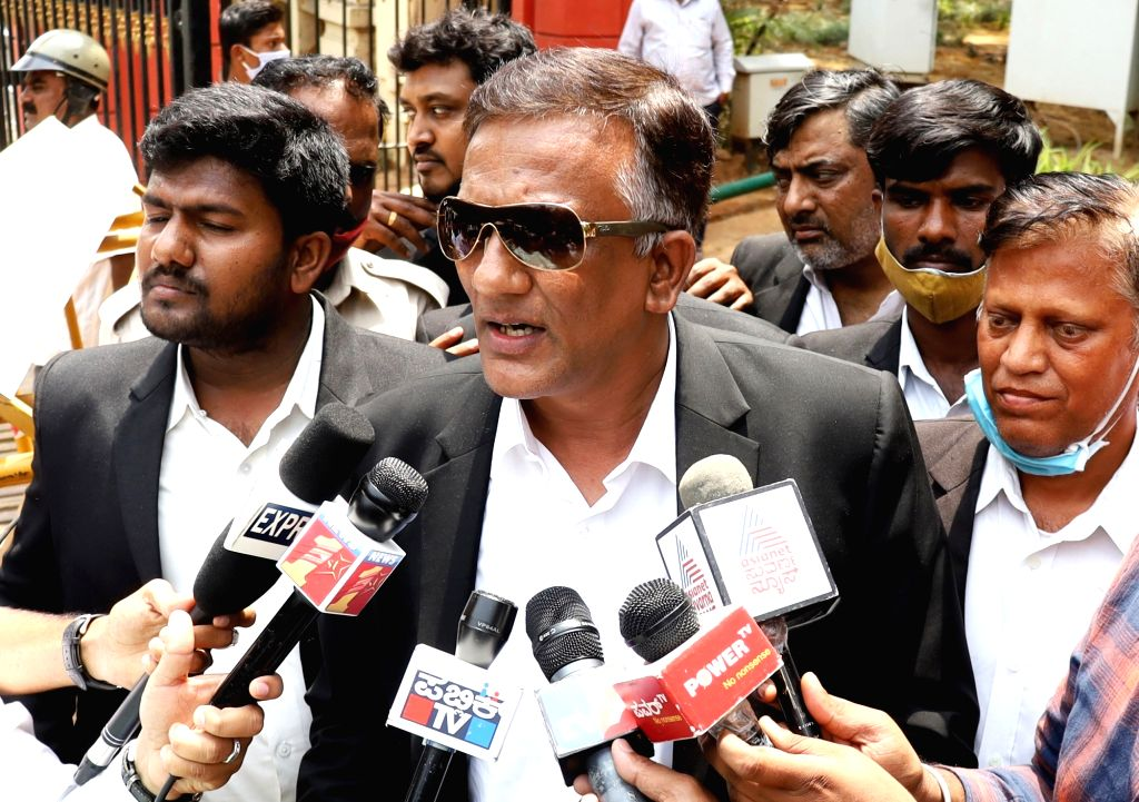 A team of lawyers led by K.N. Jagadish Kumar, representing the woman in the CD scandal addressing media at Magistrate Court, in Bengaluru on Friday 26th March 2021 - photo by IANS. - N. Jagadish Kumar