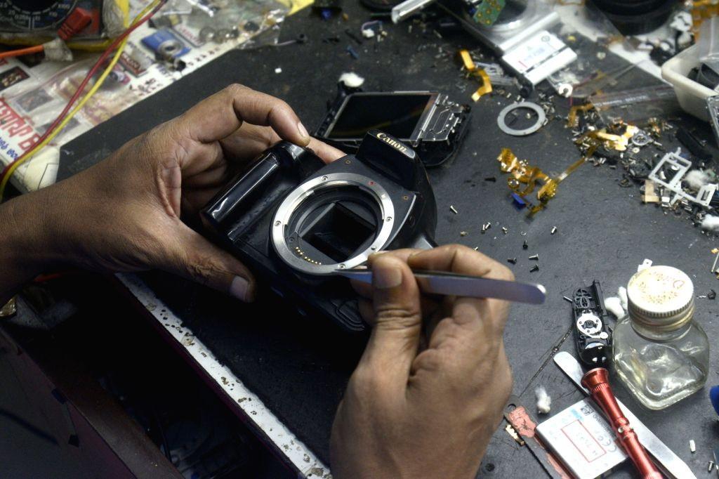 A technician repairs a camera on World Photography Day in Kolkata on Aug 19, 2017.