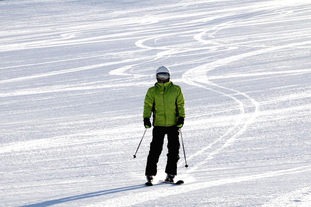 A teenager performs to greet the world snow day and international children skiing festival in Zhalantun City, north China's Inner Mongolia Autonomous Region, Jan. ...