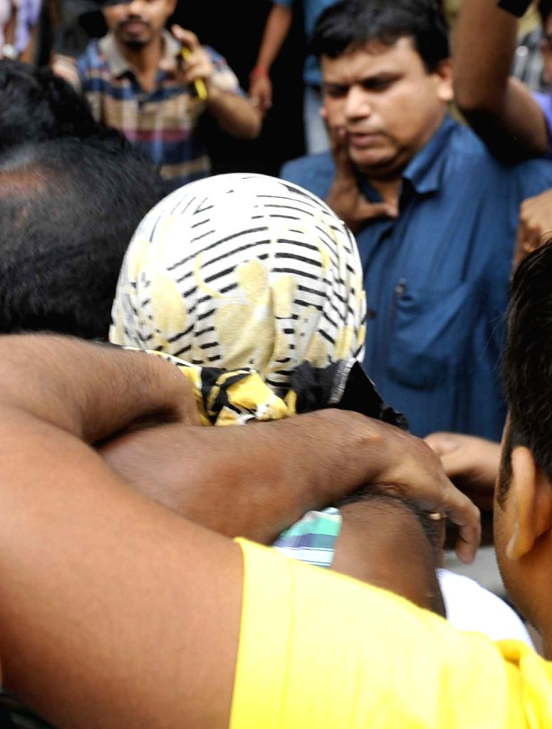 A terror suspect who was arrested by West Bengal CID from Burdwan station being taken to CID headquarters at Bhawani Bhawan in Kolkata on July 5, 2016.