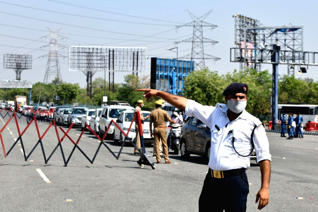 A traffic police personnel at the Delhi-Noida Border checkpoint during the extended nationwide lockdown imposed to mitigate the spread of coronavirus; on Apr 22, 2020.