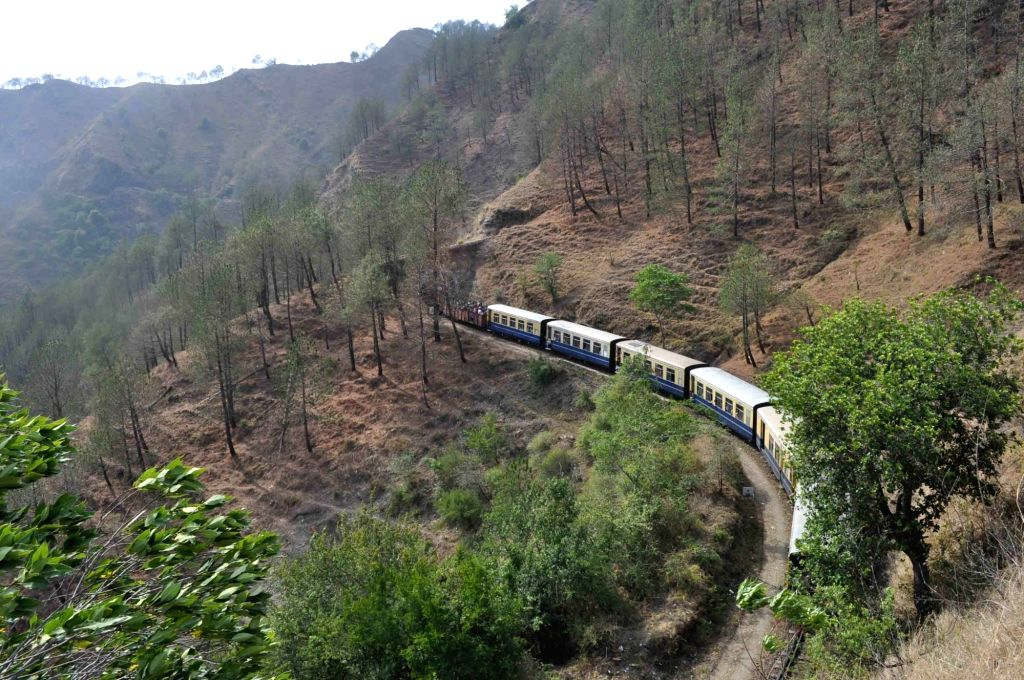 A train chugs on the British-era Unesco heritage Kalka-Shimla rail track. (File Photo: IANS)