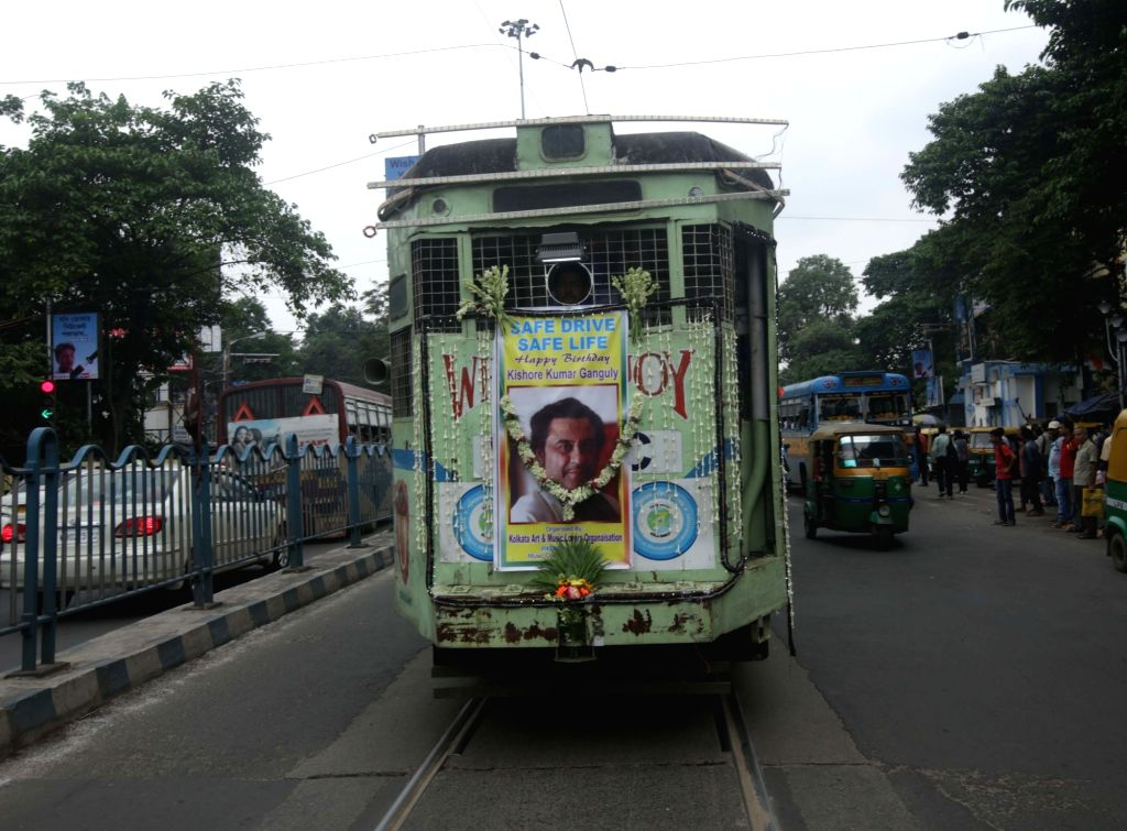 A Tram decorated with pictures of legendary singer-actor Kishore Kumar on his birthanniversary in Kolkata on Aug 4, 2017. - Kishore Kumar