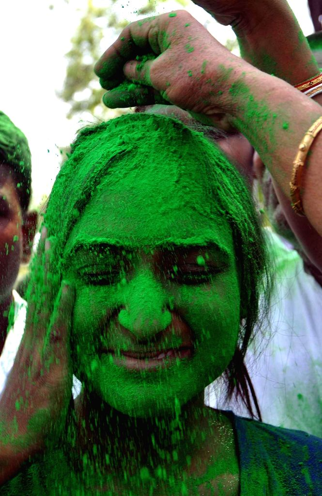 A Trinamool Congress (TMC) supporter celebrates in Kolkata on May 16, 2014. Counting of the 2014 Lok Sabha Elections is underway and the party is leading in the state.