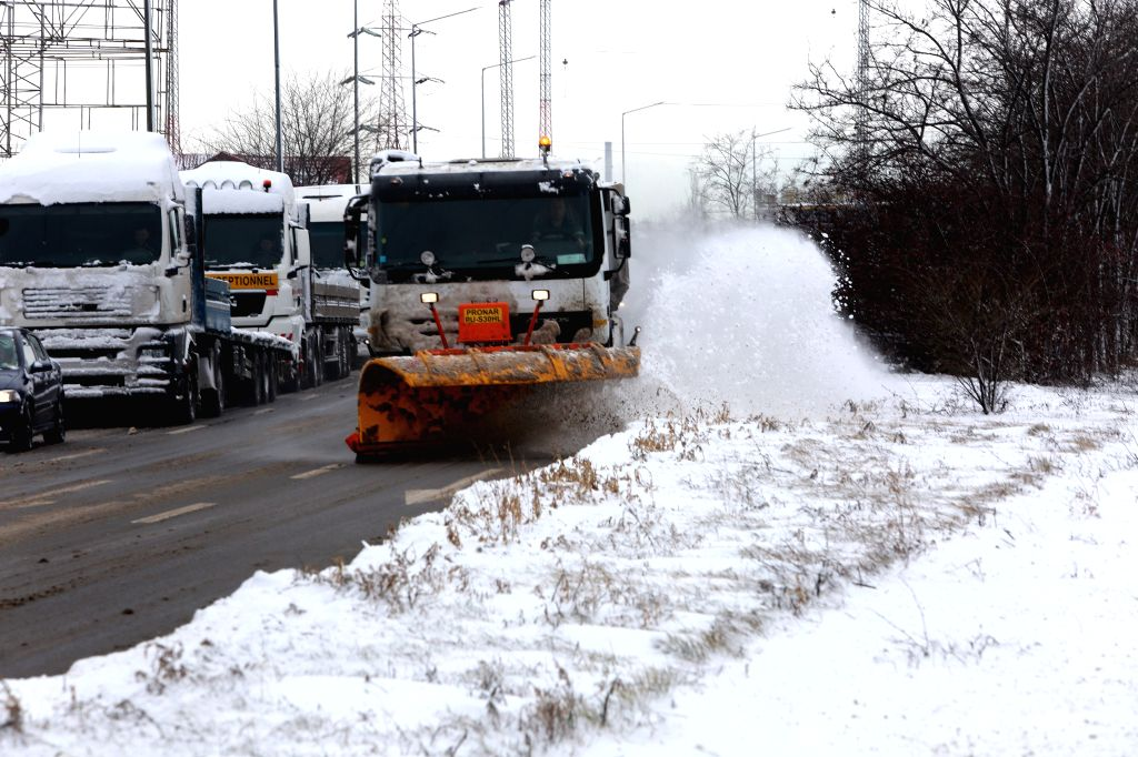 A truck cleans the snow in Bucharest, Romania, Feb. 6, 2020.