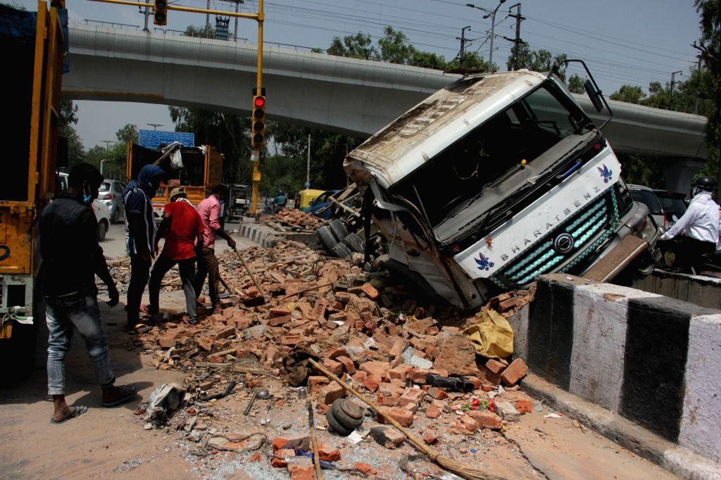 A truck rammed into a divider at Keshavpuram near Kanhaiya Nagar Metro Station in New Delhi on July 14, 2020.
