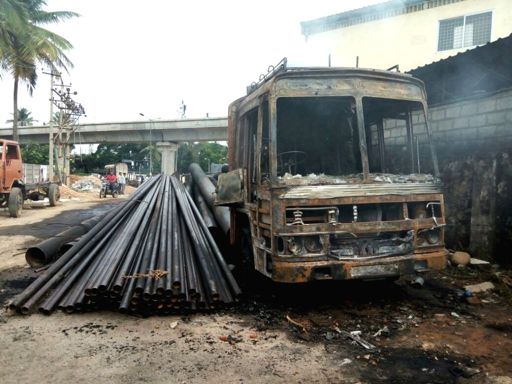 A truck with Tamil Nadu registration numbers torched by protesters on Bengaluru-Mysuru road on Sept 13, 2016. Uneasy calm prevailed in the city where one person was killed in police firing ...