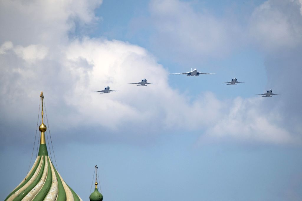 A Tu-160 strategic bomber and Tu-22M3 long-range strategic bombers fly over the Red Square during the military parade marking the 75th anniversary of the victory in ...