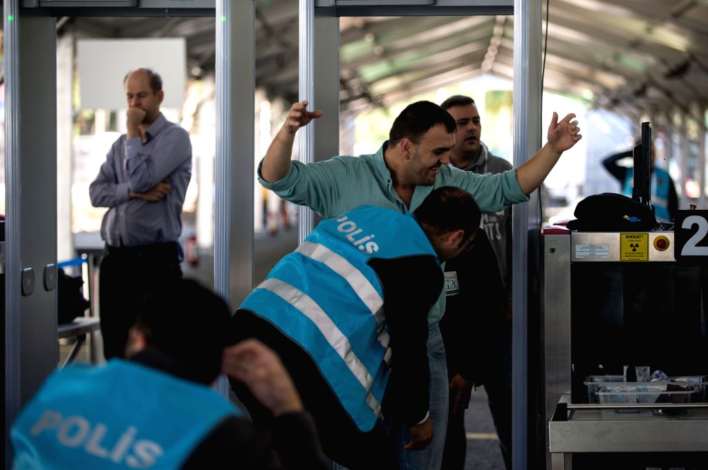 A Turkish policeman makes a security check of a man entering the main venue of G20 Summit, which will be held from Nov. 15 to 16 in Antalya, Mediterranean resort ...