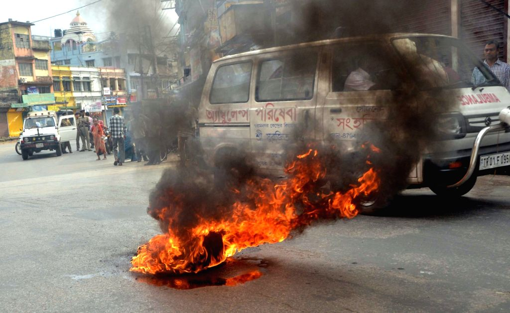 A tyre set ablaze during a 24-hour Tripura bandh called by Congress, in Agartala on April 18, 2016.