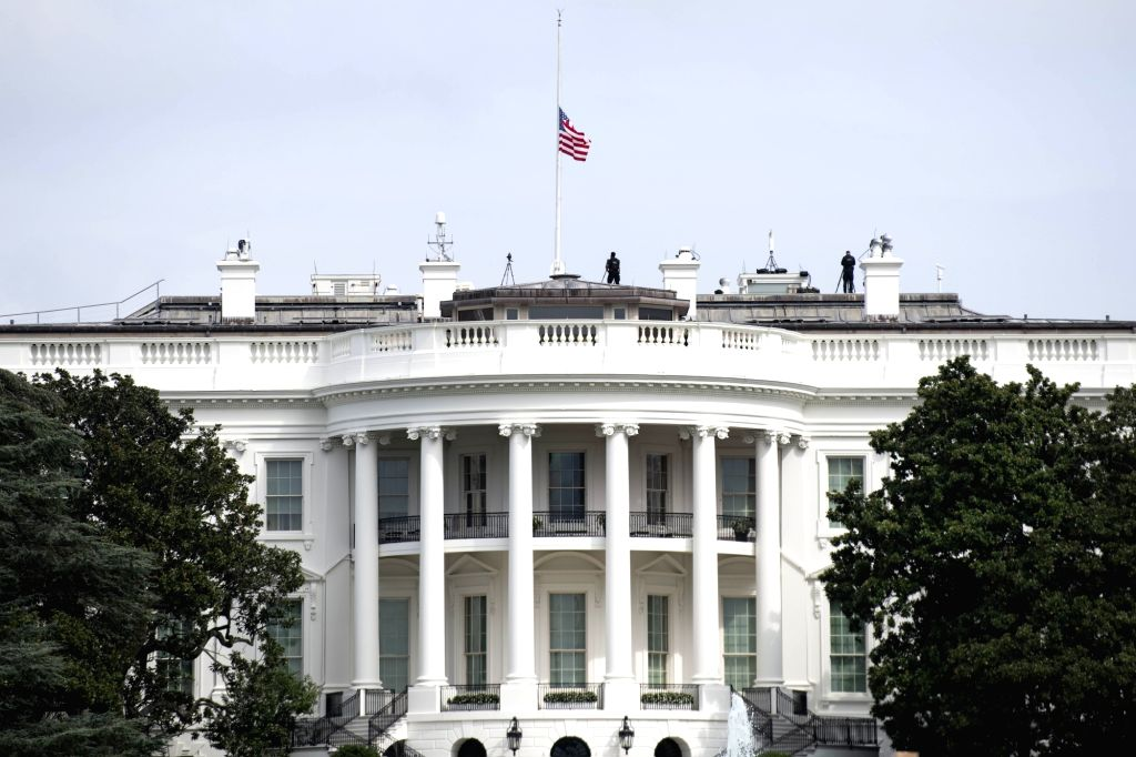 A U.S. national flag flies at half-mast at the White House in commemoration of the 19th anniversary of the 9/11 attacks in Washington D.C., the United States, ...