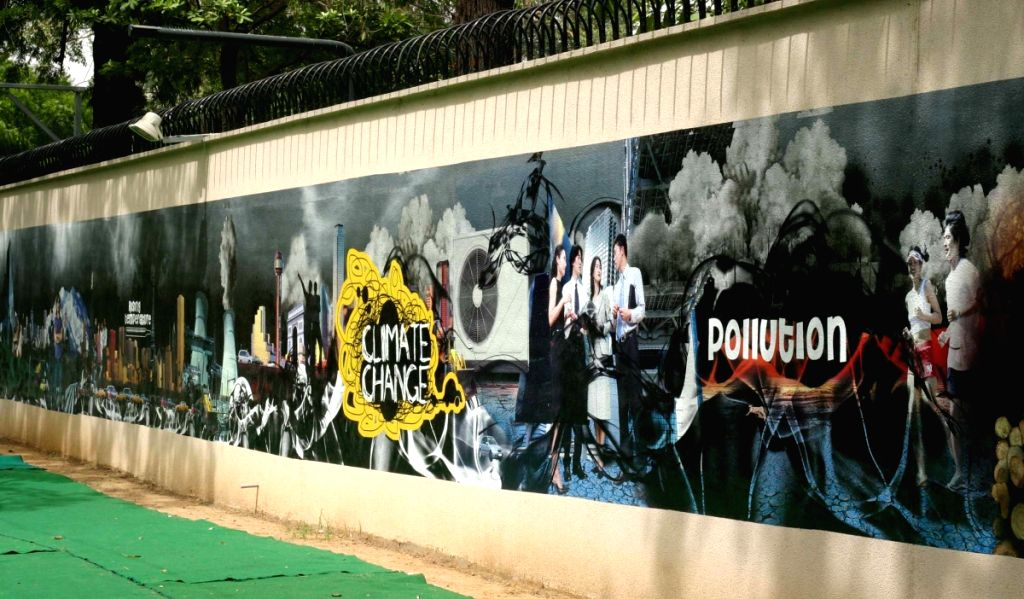 A Unique 600 Feet long wall Mural on the boundary wall of British High Commission in New Delhi on Friday. The Mural call for Global Action on Climate Change.