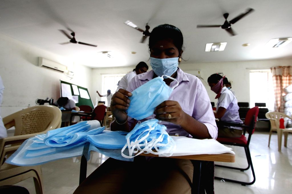 A unit member of the police team busy manufacturing masks for police personnel amid COVID-19 pandemic during the 21-day nationwide lockdown (that entered the 8th day) imposed as a ...