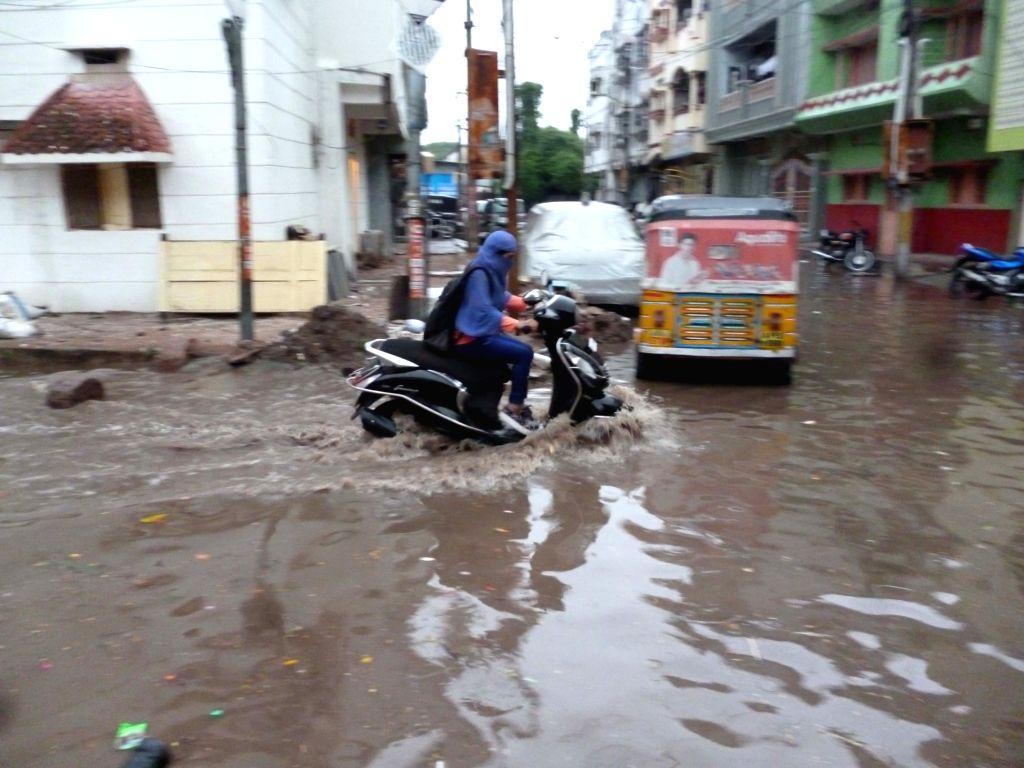 A vehicle ply on water logged roads of Hyderabad on July 19, 2016.
