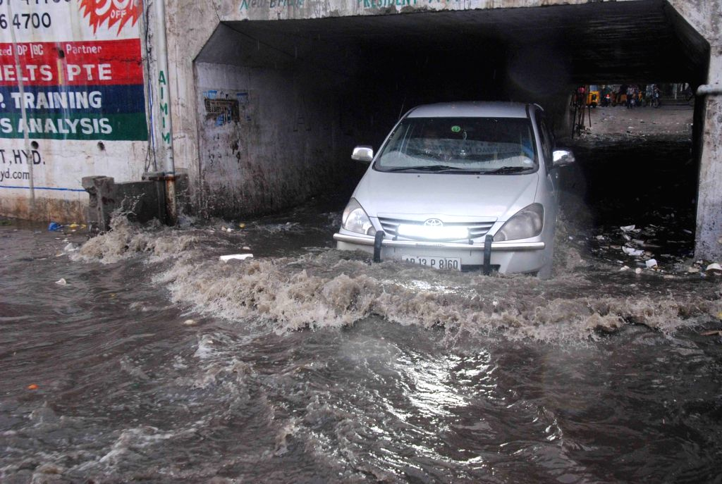 A vehicle struggles through the flooded streets after rains lashed Hyderabad on Oct 12, 2017.