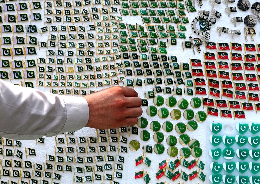 A vendor arranges badges at a stall on the eve of the Independence Day in Peshawar, Pakistan, on Aug. 13, 2020.