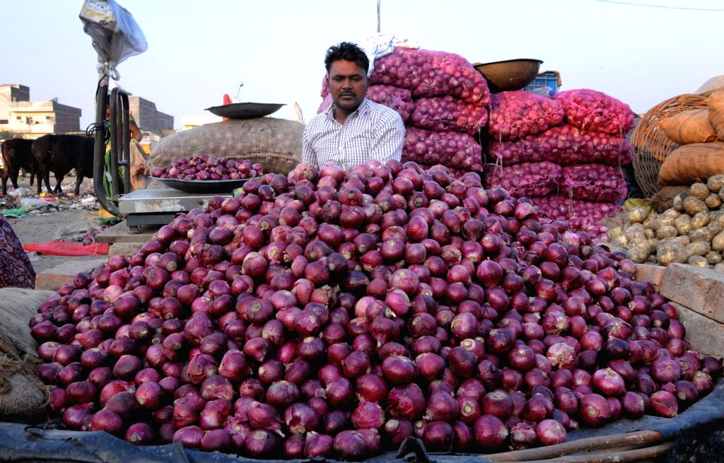A vendor arranges onions at a wholesale market in Amritsar, on Dec 4, 2019. Onion prices across the country continue to soar.