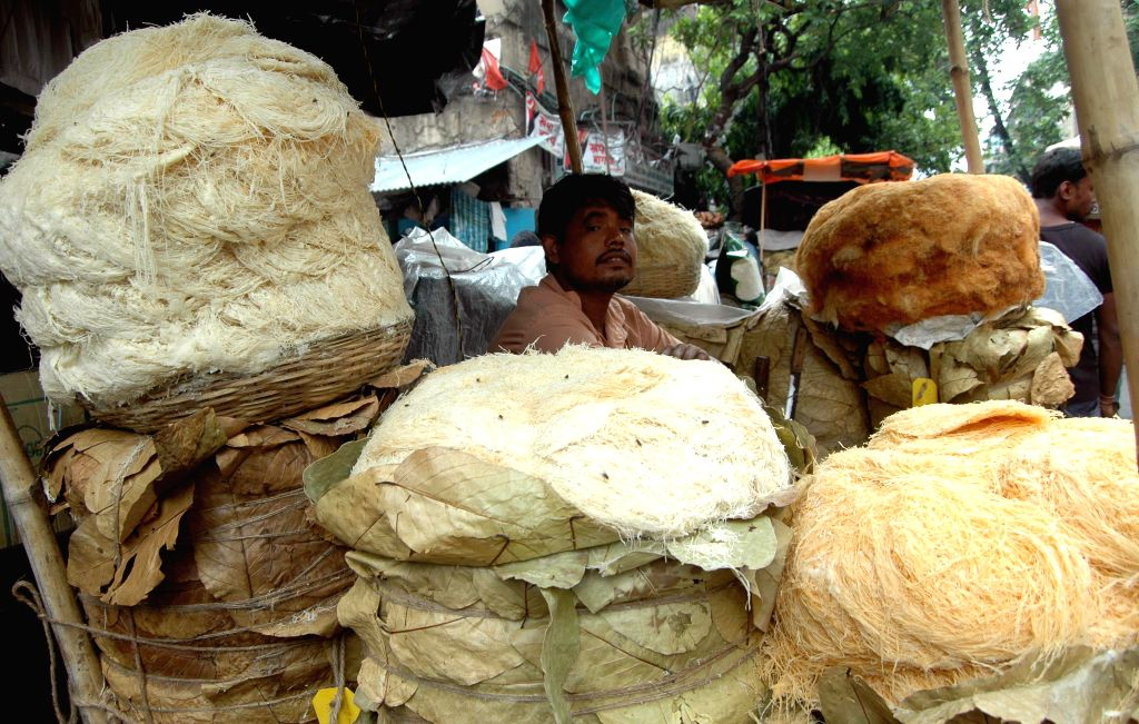 A vendor sells vermicelli in a makeshift shop during Ramadan in Kolkata on July 23, 2014.
