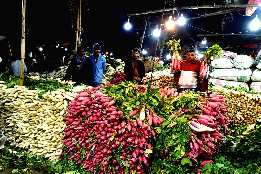 A vendor shows radishes at a wholesale shop in Karwan bazar in Dhaka, Bangladesh, Jan. 8, 2020. Karwan Bazar is one of the largest wholesale marketplaces in Dhaka.