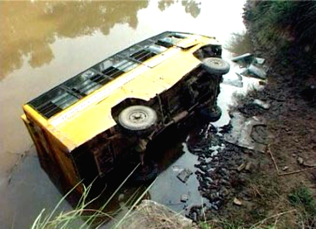 (A Video Grab) A view of a school bus that fell into a canal in Ajnala near Amritsar on July 30, 2014. Reportedly one person was killed in the accident.